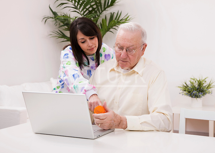 Healthcare worker helping senior man with medication