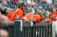 Miami Hurricanes pinch hitter Peter Crocitto (44) smiles in the dugout before Game 5 of the NCAA College World Series against the UC Santa Barbara Gauchos on June 20, 2016 at TD Ameritrade Park in Omaha, Nebraska. UC Santa Barbara defeated Miami  5-3. (Andrew Woolley/Four Seam Images)