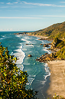 Warm afternoon light over scenic coastline near Punakaiki, Paparoa National Park, Buller Region, West Coast, New Zealand, NZ