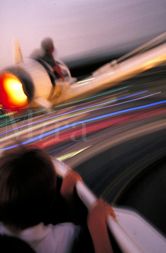 rocket ride in Disneyland's Tomorrowland. Fun, recreation, speed, motion, blur, kids, children. Los Angeles California USA Anaheim.