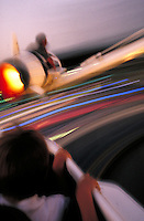 rocket ride in Disneyland's Tomorrowland. Fun, recreation, speed, motion, blur, kids, children. Los Angeles California USA Anaheim.