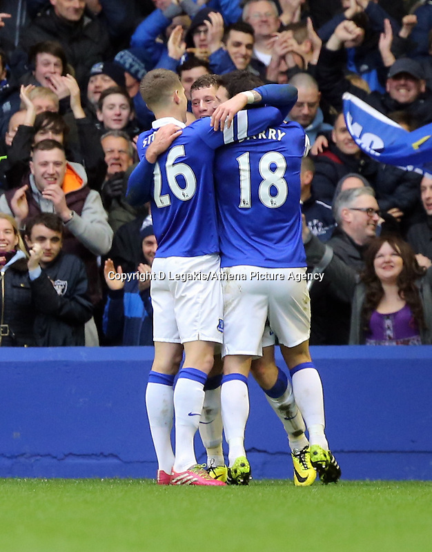 Pictured: Ross Barkley of Everton (C) is celebrating his goal with team mates. Saturday 22 March 2014<br /> Re: Barclay's Premier League, Everton v Swansea City FC at Goodison Park, Liverpool, UK.