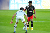 WASHINGTON, DC - NOVEMBER 8: Moses Nyeman #27 of D.C. United battles for the ball with Jorge Corrales #26 of Montreal Impact during a game between Montreal Impact and D.C. United at Audi Field on November 8, 2020 in Washington, DC.