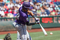 TCU Horned Frogs first baseman Michael Landestoy (13) swings the bat against the Texas Tech Red Raiders in Game 3 of the NCAA College World Series on June 19, 2016 at TD Ameritrade Park in Omaha, Nebraska. TCU defeated Texas Tech 5-3. (Andrew Woolley/Four Seam Images)
