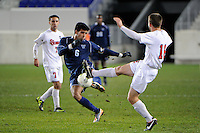 Kevin Garcia (6) of the Villanova Wildcats plays the ball as Adrian L'Esperance (16) of the St. John's Red Storm defends. St. John's defeated Villanova 2-0 during the second semifinal match of the Big East Men's Soccer Championships at Red Bull Arena in Harrison, NJ, on November 11, 2011.