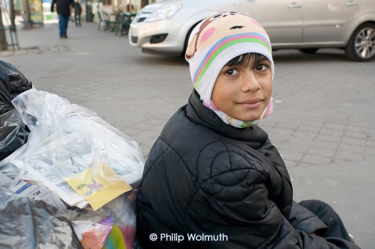 Young Roma boy begging in a Paris street.
