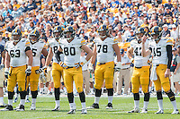 The Iowa offense awaits the start of the next play. Pictured are Austin Blythe (63), Jordan Walsh (65), Henry Krieger Coble (80), Andrew Donnal (78), John Kenny (47) and Jake Rudock (15) .Iowa Hawkeyes defeated the Pitt Panthers 24-20 at Heinz Field, Pittsburgh Pennsylvania on September 20, 2014.