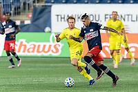 FOXBOROUGH, MA - OCTOBER 3: Gustavo Bou #7 of New England Revolution on the attack as Dax McCarty #6 of Nashville SC defends during a game between Nashville SC and New England Revolution at Gillette Stadium on October 3, 2020 in Foxborough, Massachusetts.