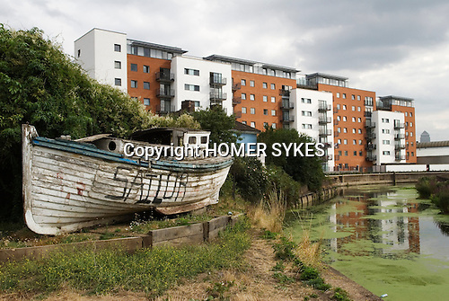 Regeneration area.  Derelict  boat called Voodoo Chile on the City Mill River Towpath.  East London the site of the 2012 Olympic Games park, village and arena. Stratford Marsh, Stratford, England 2006.