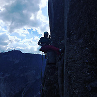 """Pictured: Lucy Foster climbs the rock in Yosemite.<br /> Re: A British climber was killed and his wife seriously injured living their """"big dream"""" on one of the toughest rock faces in the world.<br /> Andrew Foster, 32, and his wife Lucy, 28, were buried under tons of falling rock as they prepared for their climb.<br /> Experienced climber Andrew was killed but Lucy was rescued and airlifted to hospital where she was in a """"critical"""" condition.<br /> The couple were married a year ago and the three-week trip to the Yosemite National Park in California was part of their first wedding anniversary celebrations.<br /> They had ben training for the expedition for six months and flew off to the States on September 11 along with other members of their climbing club.<br /> Andrew and Lucy, from Cardiff, were scouting out a descent of the iconic rockface El Capitan when a """"sheet"""" of granite fell on them.<br /> Rangers on the national park beauty spot said a piece of granite 40 metres by 20 metres fell from a height of 200 metres while the couple were below.<br /> Patagonia, a company owned by Andrew Foster has confirmed the incident."""