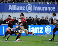 Marcelo Bosch of Saracens breaks through the tackle of Cobus Reinach of Sharks during the Sanlam Private Investments Shield match between Saracens and the Cell C Sharks at Allianz Park on Saturday 25th January 2014 (Photo by Rob Munro)