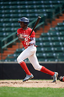 Yoansy Moreno (12) follows through on a swing during the Dominican Prospect League Elite Underclass International Series, powered by Baseball Factory, on July 21, 2018 at Schaumburg Boomers Stadium in Schaumburg, Illinois.  (Mike Janes/Four Seam Images)