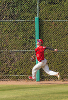 Harvard-Westlake Wolverines Pete Crow-Armstrong (21) tracks a fly ball at the fence during a High School baseball game on May 14, 2019 in Encino, California.  (Terry Jack/Four Seam Images)