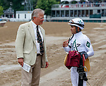 Trainer William Mott discusses Race 4  with Luis Saez Aug. 11, 2018 at the Saratoga Race Course, Saratoga Springs, NY.   (Bruce Dudek/Eclipse Sportswire)