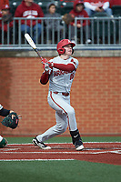 Heston Kjerstad (18) of the Arkansas Razorbacks follows through on a 2-run home run in the top of the 2nd inning against the Charlotte 49ers at Hayes Stadium on March 21, 2018 in Charlotte, North Carolina.  The 49ers defeated the Razorbacks 6-3.  (Brian Westerholt/Four Seam Images)