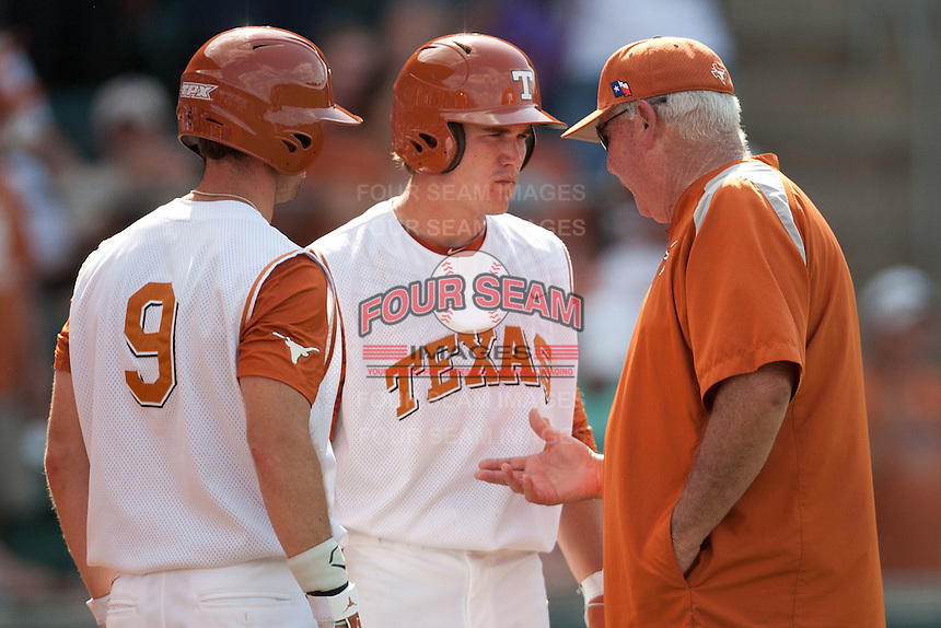 Texas Longhorns outfielder Tim Maitland #9 and second baseman Jordan Etier #7 talk with Texas Longhorns head coach Auggie Garrido #16 in the ninth inning of the NCAA baseball game against the Texas A&M Aggies on April 29, 2012 at UFCU Disch-Falk Field in Austin, Texas. The Longhorns beat the Aggies 2-1 in the last ever regular season game scheduled for the long time rivals. (Andrew Woolley / Four Seam Images)