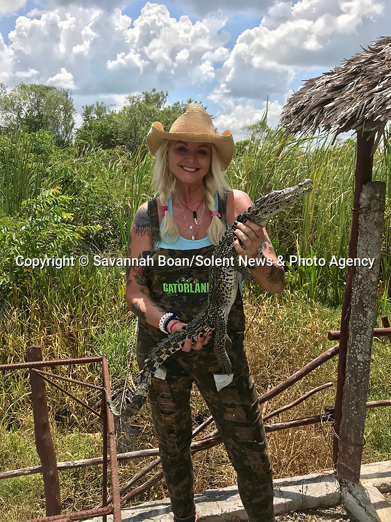 Pictured:   Savannah Boan with Cuban Crocodiles, a critically endangered species.<br /> <br /> A tiny crocodile hatchling emerges from an egg.   The new arrival is part of a conservation project focused on replenishing the declining numbers of the species.<br /> <br /> When they first hatch, the Cuban crocodiles are as small as 30cm, but will later grow to upwards of two metres when they are released into the wild.   The photos were taken by Savannah Boan at the Criadero de Cocodrilos conservation site in Playa Larga, Cuba, where between 500 and 700 crocodiles hatch every year.   SEE OUR COPY FOR DETAILS<br /> <br /> Please byline: Savannah Boan/Solent News<br /> <br /> © Savannah Boan/Solent News & Photo Agency<br /> UK +44 (0) 2380 458800