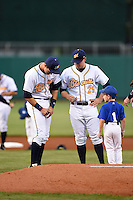 Montgomery Biscuits third baseman Richie Shaffer (12) signs an autograph for a member of the stars of the game youth baseball team before a game against the Mississippi Braves as pitcher Jared Mortensen (29) looks on on April 21, 2014 at Riverwalk Stadium in Montgomery, Alabama.  Montgomery defeated Mississippi 6-2.  (Mike Janes/Four Seam Images)