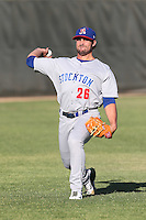 Tim Atherton #26 of the Stockton Ports warms up before pitching against the Lancaster JetHawks at The Hanger on June 24, 2014 in Lancaster, California. Stockton defeated Lancaster, 6-4. (Larry Goren/Four Seam Images)