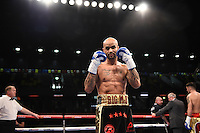 Leon McKenzie celebrates his first round win over Kelvin Young during their Final Eliminator contest for English Super-Middlweight Championship at the Copper Box Arena, London, England on 30 January 2016. Photo by Alan  Stanford.