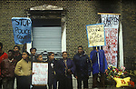 New Cross Fire Massacre March 1981. Local people gather outside the house in New Cross where 13 young adults died in a blaze.  1980s UK. <br /> The New Cross Fire was a devastating house fire which killed 13 young black people during a birthday party in New Cross, southeast London on Sunday 18 January 1981. Some were shocked by what they perceived as the indifference of the white population, and accused the London Metropolitan Police of covering up the cause, which they suspected was an arson attack motivated by racism; the protests arising out of the fire led to a mobilisation of black political activity. Nobody has ever been charged in relation to the fire