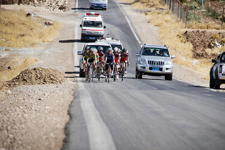 SULAIMANIYAH, IRAQ: Newroz and Dukan cycling clubs climb a hill during the individual team race.  They race on an open road with regular traffic in temperatures of over 30ºC.<br /> <br /> Nyan Yassin, 24, is a professional competitive cyclist in Sulaimaniyah in the semi-autonomous region of Iraqi Kurdistan.  She is the captain of an all-female club called Newroz Club, which is the only cycling club for women in Sulaimaniyah, although there are other clubs around Iraq.  She trains and competes on roads that are badly surfaced and busy with traffic.<br /> <br /> Nyan was the first woman to start cycling in Sulaimaniyah.  She was always competitive and after trying her hand at different sports she settled on cycling.  She is now the top female cyclist in Iraq.  Her nickname is MigMig after the noise made by the cartoon character Roadrunner.<br /> <br /> Despite being clearly talented at her sport Nyan knows that in a couple of years she will have to get married and then abandon it as, in the traditional society that Kurdistan is, being a wife and a competitive sportswoman at the same time is not an option.<br /> <br /> Photo by Gona Hassan/Metrography