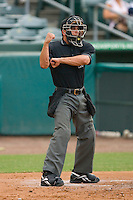 Home plate umpire Roberto Medina signals a strike during a Florida State League game between the Charlotte Stone Crabs and the Jupiter Hammerheads at Roger Dean Stadium June 15, 2010, in Jupiter, Florida.  Photo by Brian Westerholt /  Seam Images