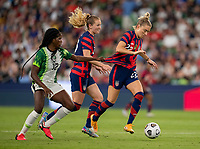 AUSTIN, TX - JUNE 16: Ijeoma Okonronkwo #12 of Nigeria grabs the jersey of Kristie Mewis #22 of the USWNT during a game between Nigeria and USWNT at Q2 Stadium on June 16, 2021 in Austin, Texas.