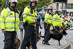 © Joel Goodman - 07973 332324 - all rights reserved . 03/06/2017 . Liverpool , UK . Riot police and dog handlers separate the two sides . Hundreds of police manage a demonstration by the far-right street protest movement , the English Defence League ( EDL ) and an demonstration by opposing anti-fascists , including Unite Against Fascism ( UAF ) . Photo credit : Joel Goodman