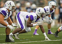8 October 2016: Amherst College Purple & White Defensive Lineman Markel Thomas, a Junior from Chicago, IL, lines up against the Middlebury College Panthers at Alumni Stadium in Middlebury, Vermont. The Panthers edged out the Purple & While 27-26. Mandatory Credit: Ed Wolfstein Photo *** RAW (NEF) Image File Available ***
