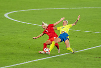 YOKOHAMA, JAPAN - AUGUST 6: Adriana Leon #9 of Canada is tackled by Nathalie Bjorn #14 of Sweden during a game between Canada and Sweden at International Stadium Yokohama on August 6, 2021 in Yokohama, Japan.