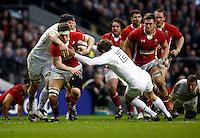 Photo: Richard Lane/Richard Lane Photography. England v Wales. 25/02/2012. Wales' Ryan Jones is tackled by England's Ben Morgan and Toby Flood.