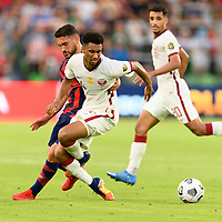 AUSTIN, TX - JULY 29: Cristian Roldan #10 of the United States and Homam Ahmed #14 of Qatar battle for control of the ball during a game between Qatar and USMNT at Q2 Stadium on July 29, 2021 in Austin, Texas.