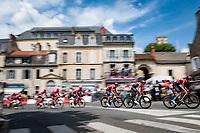 peloton rolling through town<br /> <br /> Stage 7 from Vierzon to Le Creusot (249km)<br /> 108th Tour de France 2021 (2.UWT)<br /> <br /> ©kramon