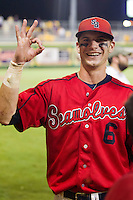 """Stony Brook Seawolves outfielder Travis Jankowski #6 smiles and signals """"the O"""" following the NCAA Super Regional baseball game against LSU on June 10, 2012 at Alex Box Stadium in Baton Rouge, Louisiana. Stony Brook defeated LSU 7-2 to advance to the College World Series in Omaha. (Andrew Woolley/Four Seam Images)"""