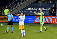 KANSAS CITY, KS - NOVEMBER 22: Tim Melia #29 of Sporting KC celebrates his team's qualification to the next round as Cristian Espinoza #10 of the San Jose Earthquakes looks on before a game between San Jose Earthquakes and Sporting Kansas City at Children's Mercy Park on November 22, 2020 in Kansas City, Kansas.