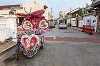 A Trishaw, Popular among Tourists as an Alternative to Walking.  Melaka, Malaysia.