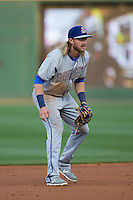 Durham Bulls shortstop Taylor Motter (11) on defense against the Charlotte Knights at BB&T BallPark on April 14, 2016 in Charlotte, North Carolina.  The Bulls defeated the Knights 2-0.  (Brian Westerholt/Four Seam Images)