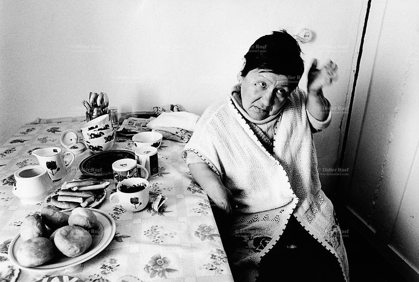 Kazakhstan. Sarzhal. Sandugash Imangaliyera suffers from a genetic malformation disease (legs, hands). She is 58 years old and was born near the Semipalatinsk Polygon ( called today National Nuclear Center of Kazakhstan). Sandugash Imangaliyera is a first generation victim of the 456 atomic testing - 116 atmospheric, 340 underground - from 1949 to 1989. The regions high frequency of  diseases is primarily due to fallout from nearby nuclear test sites. Sandugash Imangaliyera shows the human and environmental effects of nuclear radiation, genetic contamination and pollution from atomic tests programs of the former Soviet Union. Sarzhal is located in the Eastern Kazakhstan Province. © 2008 Didier Ruef .