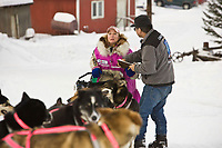 Resident checker Billy Honea checks in Dee Dee Jonrowe at Ruby on Friday during the 2008 Iditarod