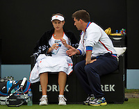 Netherlands, Den Bosch, 16.06.2014. Tennis, Topshelf Open, Jana Cepelova (SVK) gets some tips from her coach during changeover<br /> Photo:Tennisimages/Henk Koster
