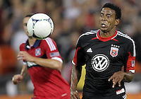 WASHINGTON, DC. - AUGUST 22, 2012:  Lionard Pajoy (26) of DC United meets a cross against the Chicago Fire during an MLS match at RFK Stadium, in Washington DC,  on August 22. United won 4-2.