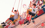 CHESHIRE,CT-9/26/98-0926CK05.tif-Patrick Fleck age 9 and his friend Brice Burgess age 9 of Naugatuck spin round and round on the swing ride at the Cheshire Fall Festival on Saturday.    CASEY KEIL PHOTO.