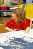 MR / Schenectady, New York.Yates Arts-in-Education Magnet School / Pre-Kindergarten.Student uses shaving cream during art and sensory experience activity. (Girl: 4).MR: Las1 *2.PN#:26802      FC#:20332-00410.scan from slide.© Ellen B. Senisi