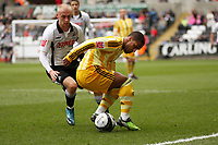 ATTENTION SPORTS PICTURE DESK<br /> Pictured: David Cotterill of Swansea City battles with Wayne Routledge of Newcastle United<br /> Re: Coca Cola Championship, Swansea City Football Club v Newcastle United at the Liberty Stadium, Swansea, south Wales. 13 February 2010