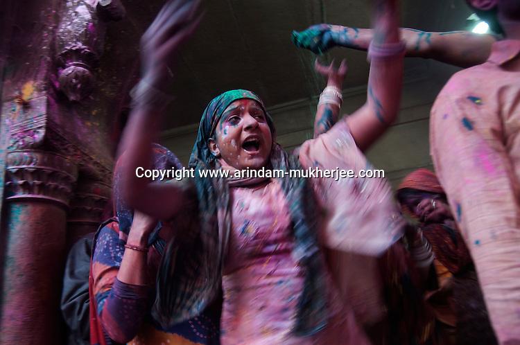 Singing and dancing is a part of Holi celebration at Banke Bihari Temple in Vrindavan, 8th March 2012, Uttar Pradesh, India.