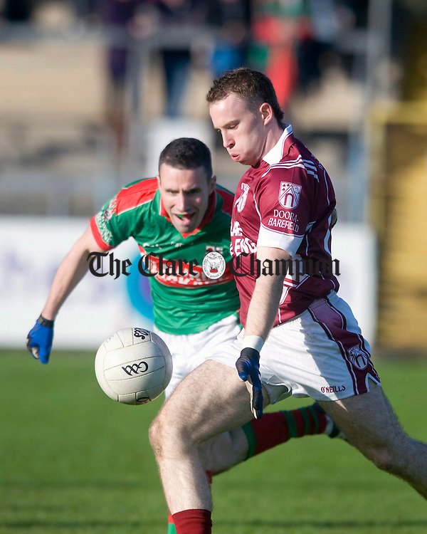 Enda Lyons of St Joseph's shoots as Shane Hickey closes in. Photograph by Declan Monaghan