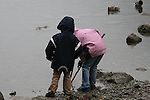Children on the shore at Lake Königssee, Germany.  Oct. 6, 2007.