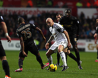 Wednesday, 01 January 2014<br /> Pictured: Jonjo Shelvey of Swansea (C) against Fernandinho (L) and Yaya Toure (R) of Manchester City.<br /> Re: Barclay's Premier League, Swansea City FC v Manchester City at the Liberty Stadium, south Wales.