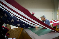 21 June 2005 - Oaks, PA - Connie Roby assembles parts of an American flag at the Annin & Co. flag manufacturing plant in Oaks, PA. Photo Credit: David Brabyn.